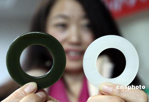 资料图:昆仑玉将作为2008北京奥运会奖牌用玉。