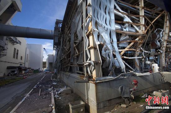 资料图:受灾后的日本福岛第一核电站。中新社发