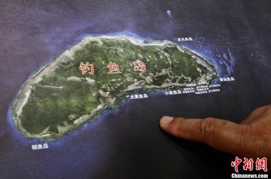资料图:《中华人民共和国钓鱼岛及其附属岛屿》专题地图。图为该地图上的钓鱼岛,其中可以看出岛上的植被情况。中新社发 张浩 摄