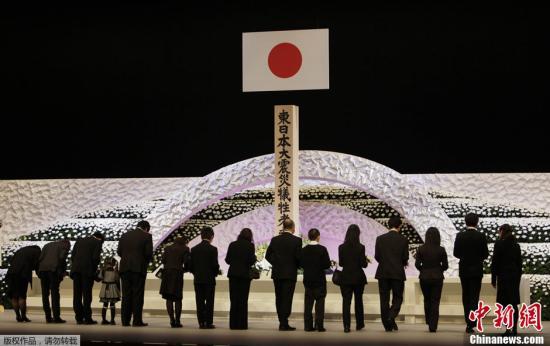 """资料图:日本政府举办""""3·11""""东日本大地震追悼仪式。"""