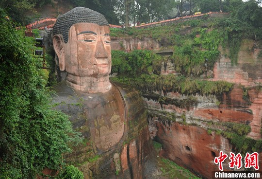 China's giant stone Buddha to undergo repairs for cracks across chest