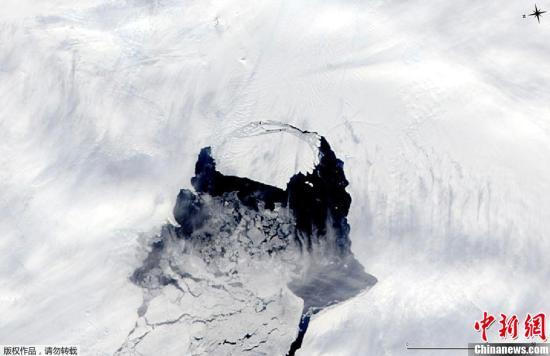 资料图:美国宇航局气象卫星拍摄到正在开裂的南极松岛冰川。