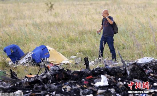 美媒:MH17空难国际调查组仍在等待进入事发地点