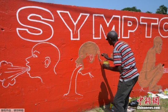 当地时间2014年9月8日,在利比里亚,蒙罗维亚街头,一名叫斯蒂芬·多伊的艺术家在墙上创作壁画向人们介绍致命的埃博拉病毒病发症状。世界卫生组织8日发出警告,利比里亚已经成为西非受埃博拉疫情肆虐最严重的国家,该国因疫情死亡的人数已经占整个西非发病死亡人数的一半以上。