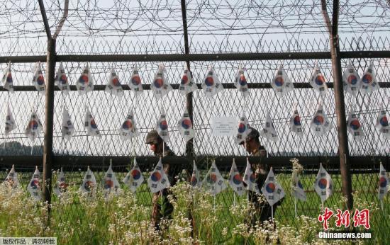 资料图片:韩朝在位于京畿道坡州市的军事分界线(MDL)。