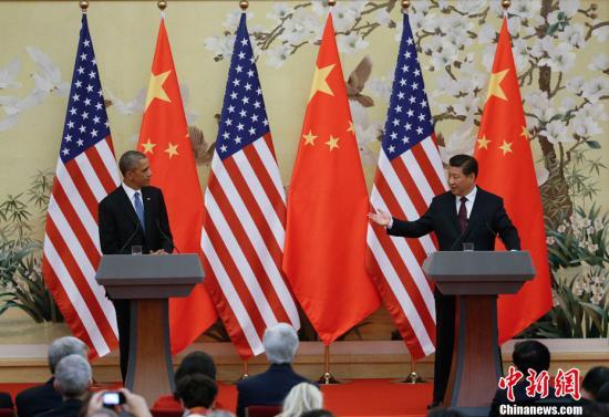 资料图:2014年11月12日,中国国家主席习近平、美国总统奥巴马在北京共同会见记者。中新社发 杜洋 摄