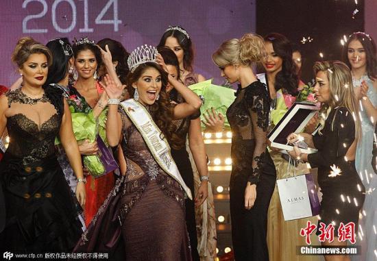 当地时间2014年11月22日,黎巴嫩贝鲁特,2014环球旅游小姐举行,委内瑞拉美女Ninoska Vasquez夺得桂冠。图片来源:CFP视觉中国