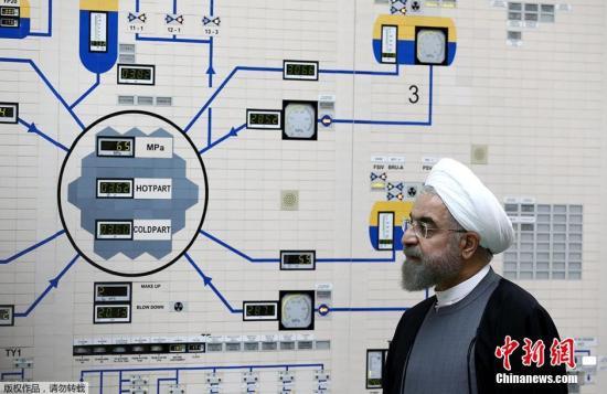 当地时间1月13日,伊朗布什尔,伊朗总统鲁哈尼参观布什尔核电站。
