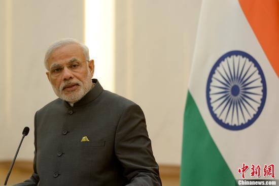 5月15日,中国国务院总理李克强与印度总理莫迪在北京人民大会堂共同会见记者。中新社发 廖攀 摄