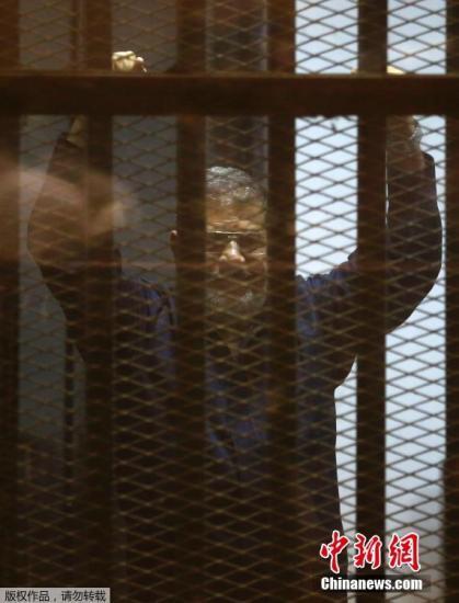 资料图:埃及前总统穆尔西。