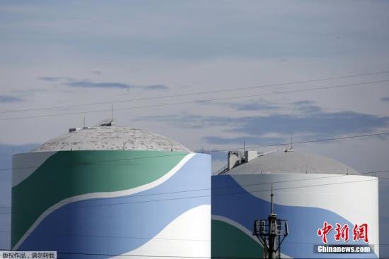 图为川内核电站1号、2号反应堆。这将是福岛第一核电站发生事故后,日本按照新的核电站安全标准重启的首座反应堆。