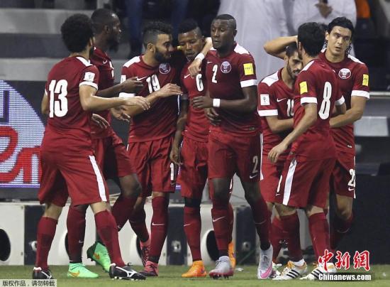 资料图:卡塔尔队在比赛中。