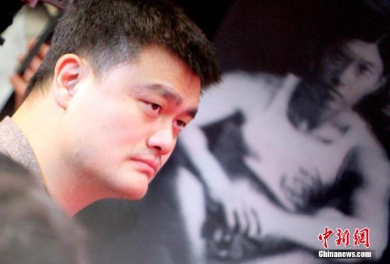 """资料图:退役后,姚明成为了""""姚老板""""。中新社记者 张道正 摄"""
