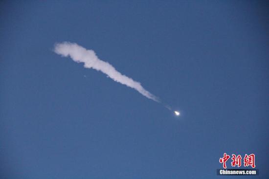 """中国首颗暗物质卫星""""悟空""""发射升空。中新社记者 张素 摄"""