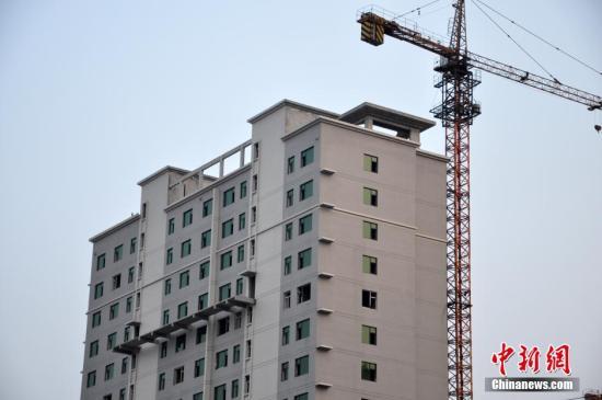 资料图:一在建楼盘。 图片来源:视觉中国