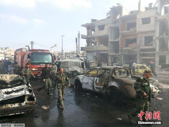 资料图:叙利亚中部城市霍姆斯市遭遇2起汽车炸弹袭击,造成57人死亡,另有上百人受伤。