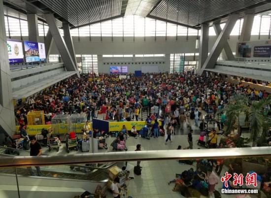 资料图片:菲律宾首都马尼拉国际机场3号航站楼。 <a target='_blank' href='http://www-chinanews-com.tadacipdaily.com/'>中新社</a>记者 吕安 摄