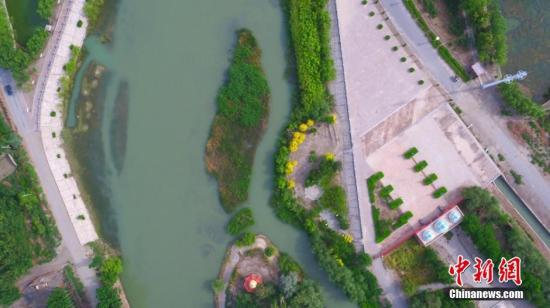 资料图:城市绿化建设。 确・胡热 摄