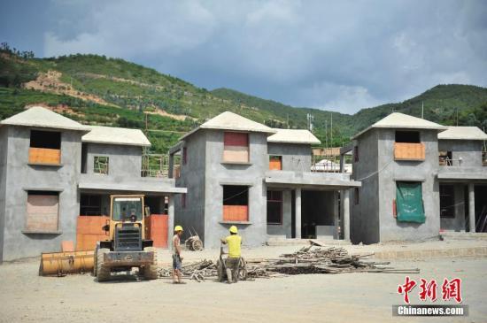 资料图:易地扶贫搬迁安置点开工。 中新社记者 刘冉阳 摄
