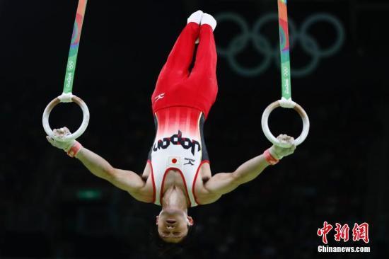 当地时间8月10日,在里约奥运会体操男子个人全能决赛中,日本名将内村航平以总成绩92.365分成功卫冕。<a target='_blank' href='http://www.chinanews.com/' >中新网</a>记者 富田 摄