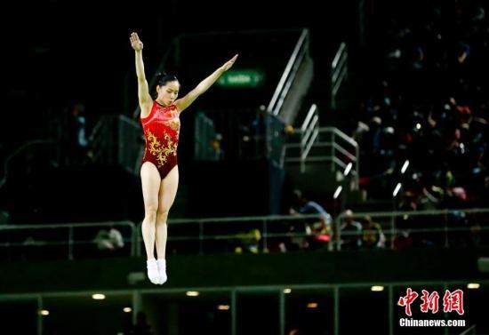 当地时间8月12日,2016里约奥运会女子蹦床,澳门二十一点游戏选手李丹以55.885分获得铜牌。图为李丹在比赛中。中新网记者 杜洋 摄