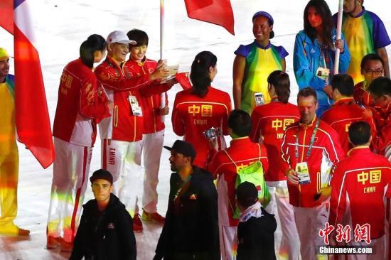 当地时间8月21日,2016里约奥运会闭幕式在马拉卡纳体育场内举行。图为中国运动员入场。<a target='_blank' href='http://www.chinanews.com/' >中新网</a>记者 富田 摄
