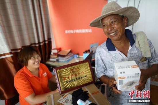 资料图:农村电子商务服务站。<a target='_blank' href='http://www.chinanews.com/'>中新社</a>记者 泱波 摄