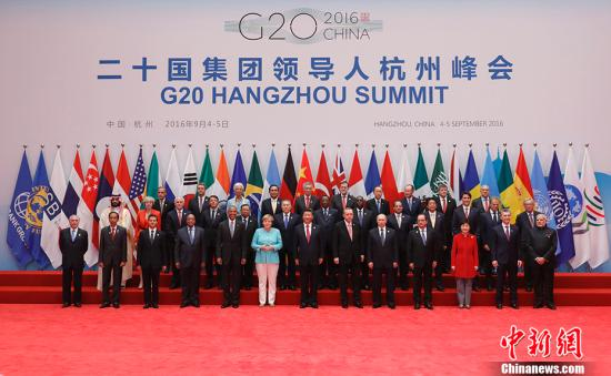 9月4日,二十国团体指导人杭州峰会在杭州举办。国家国度主席习近平同预会指导人合影。 中新社记者 盛佳鹏 摄