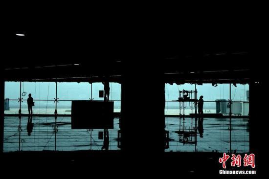 资料图:正在建设的重庆机场东航站区。<a target='_blank' href='http://www-chinanews-com.ri-vista.com/'>中新社</a>记者 陈超 摄