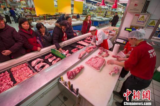 商务部:上周食?#38376;?#20135;品价格回升 猪肉比前一周上涨2.4%