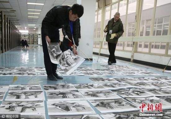资料图:美术统考阅卷现场。 图片来源:视觉中国