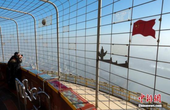 资料图:北京蓝天。 中新社记者 侯宇 摄