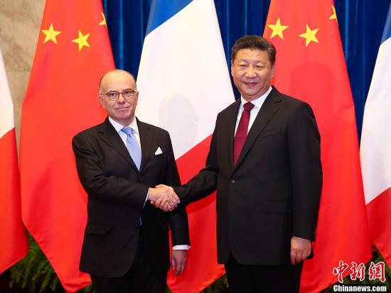 2月22日,中国国家主席习近平在北京人民大会堂会见法国总理卡泽纳夫。<a target='_blank' href='http://www.chinanews.com/'>中新社</a>记者 刘震 摄