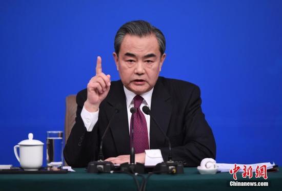 资料图片,外交部部长王毅回答记者提问。中新社记者 侯宇 摄