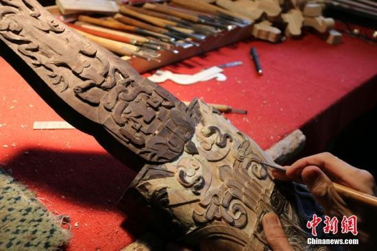 Young man polishes business with Chinese lacquerwork