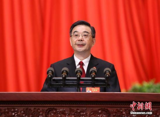 3月12日,十二届全国人大五次会议在北京人民大会堂举行第三次全体会议,最高人民法院院长周强作最高人民法院工作报告。 记者 刘震 摄
