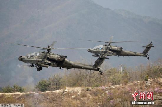 资料图:美军AH-64阿帕奇武装直升机。