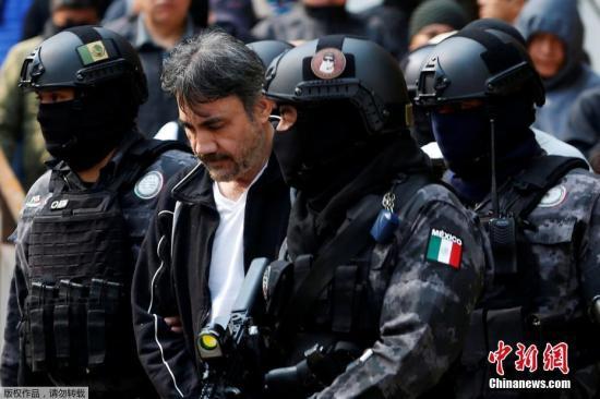 资料图:墨西哥毒枭古斯曼被捕。