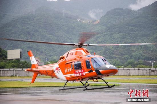 资料图:直升机参与救援行动。 李南轩 摄