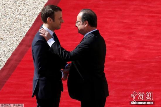 资料图:法国总统马克龙与前总统奥朗德。
