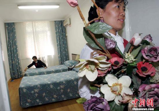 资料图:宾馆推出高考房,为考生提供学习环境。 中新社发 张勤 摄 图片来源:CNSphoto