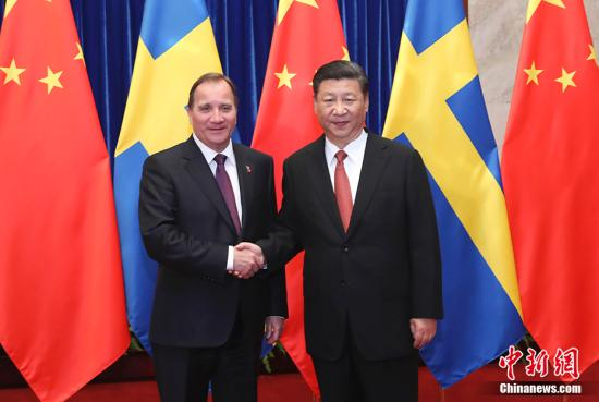 6月26日,中国国家主席习近平在北京人民大会堂会见瑞典首相勒文。 中新社记者 杜洋 摄