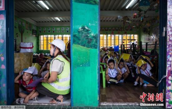 资料图片:菲律宾举行全国联合地震演习。