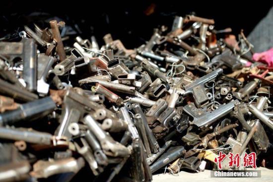 资料图片:枪支。