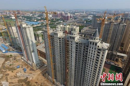 资料图:在建商品房。 <a target='_blank' href='http://www.chinanews.com/'>中新社</a>记者 韦亮 摄