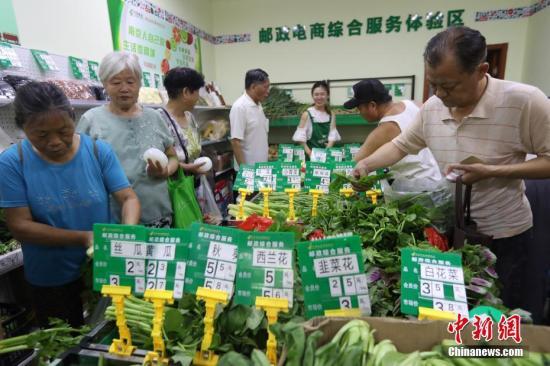 资料图:农产品销售。中新社记者 泱波 摄