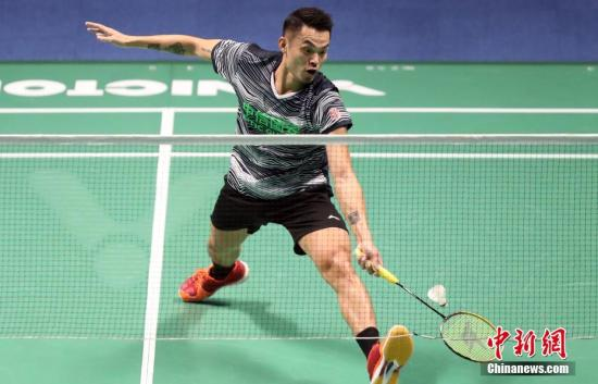 9月3日,天津全运会羽毛球男团决赛在宝坻体育馆举行,北京队3比2胜福建队,夺得冠军。图为北京队林丹在比赛中。中新社记者 张宇 摄
