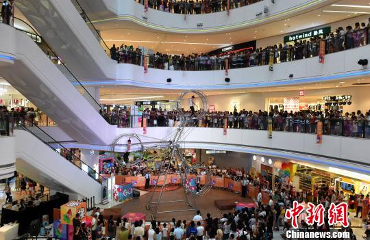 资料图:重庆一商场。周毅 摄