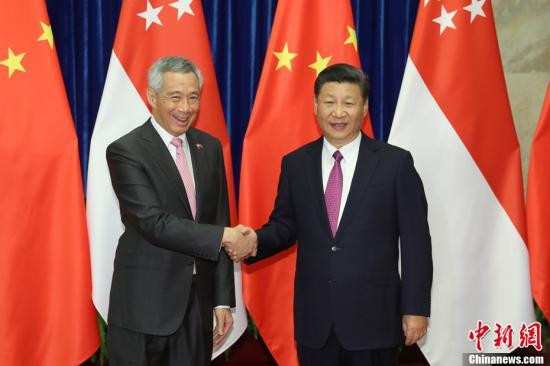 9月20日,中国国家主席习近平在北京人民大会堂会见新加坡总理李显龙。中新社记者 盛佳鹏 摄