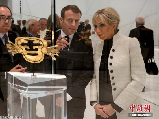 资料图:法国总统马克龙与夫人。
